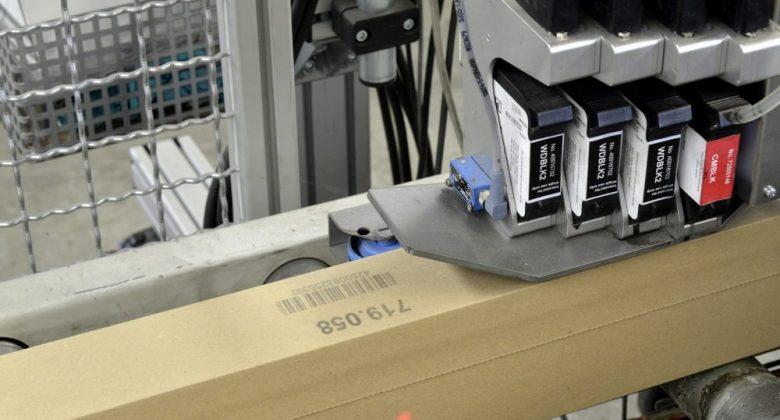 Markoprint inkjet printer coding on carton in production line
